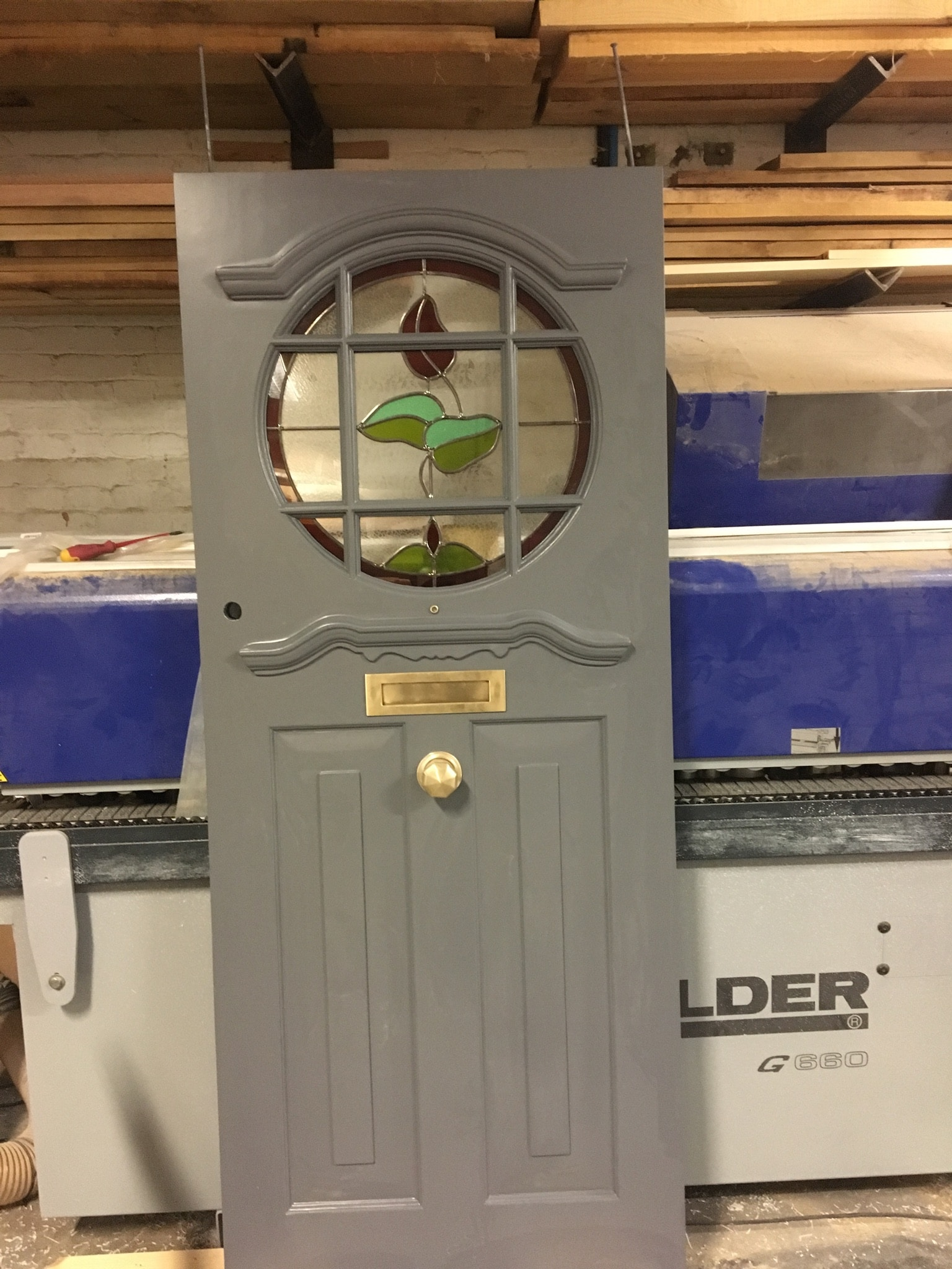 Hardwood front door, two panel and decorative glazed circle. glass with bars.