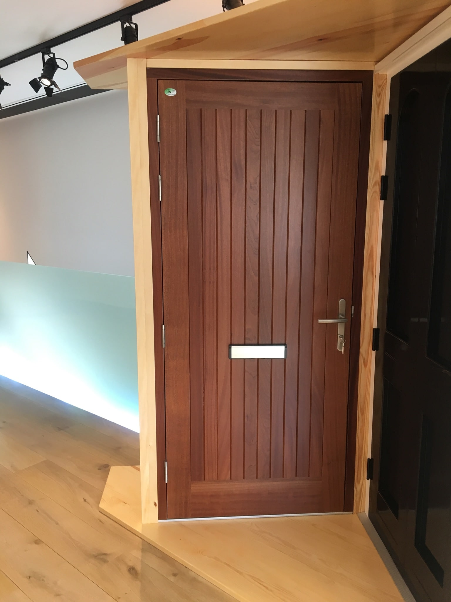 Hardwood flash door, open out, with letter box. Fully factory finished.