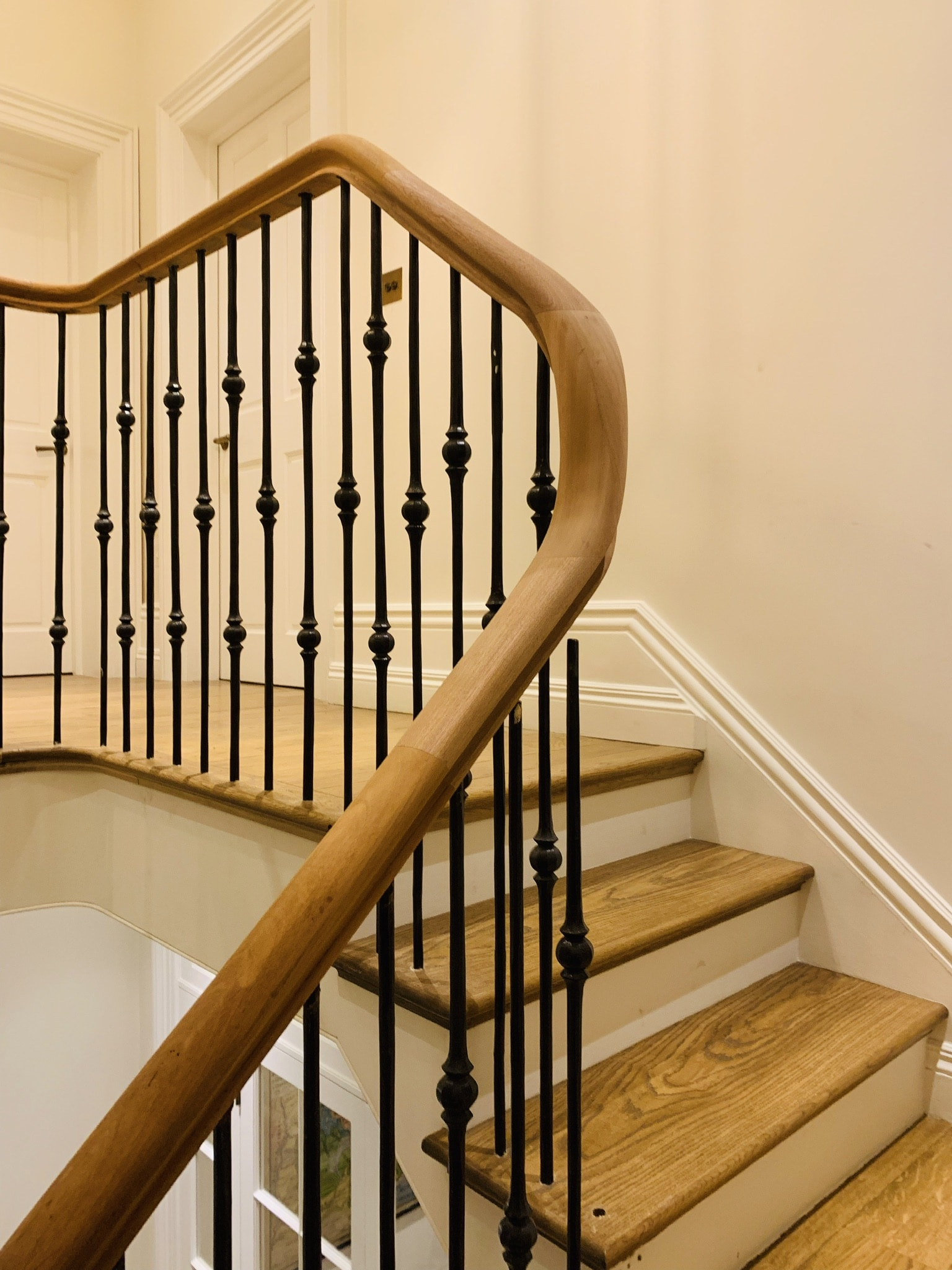 Special design of curved handrail. Hardwood.