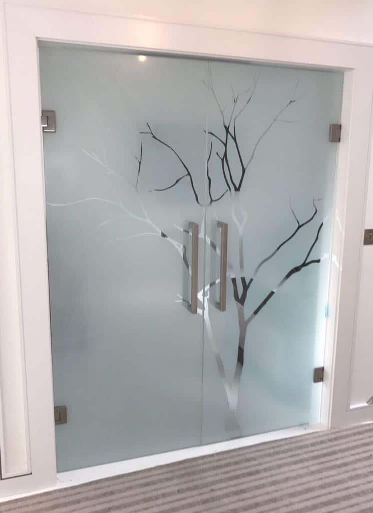 Glass door to bathroom ensuite. Toughened/ Laminated decorative glass and foil applied.