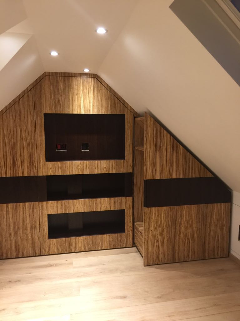 Bespoke loft TV unit with storage in Zibrano finish.
