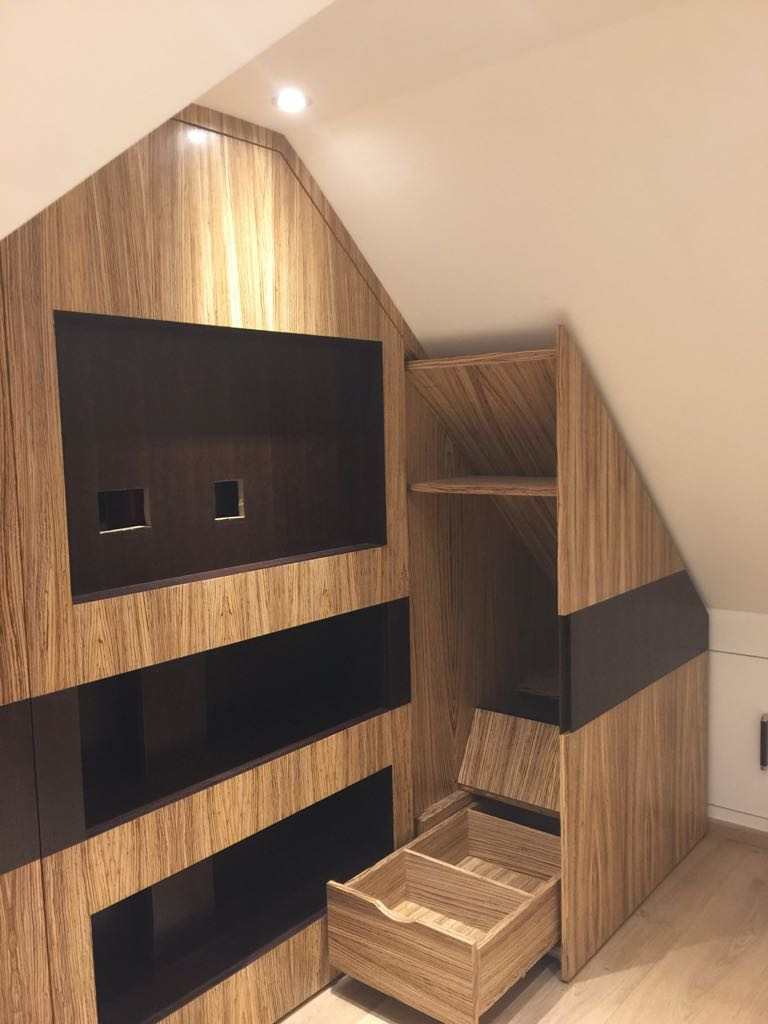 Bespoke loft TV unit with storage in Zibrano finish.