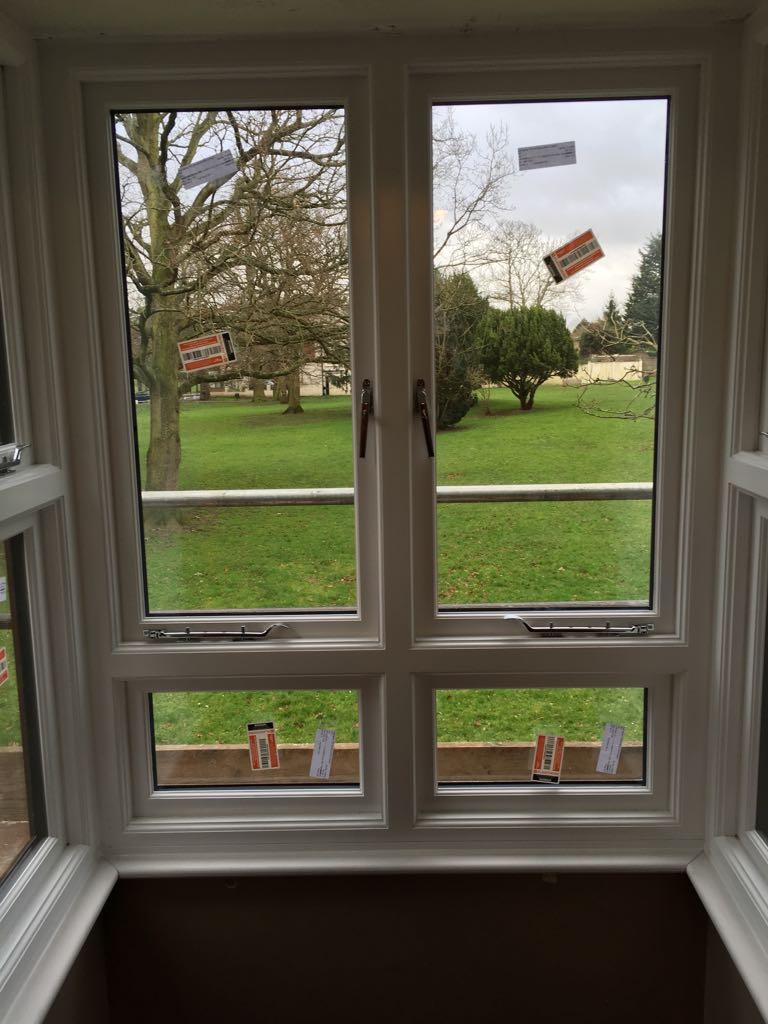 Double glazed casement window with fixed bottom screen. All ironmongery in satin chrome.