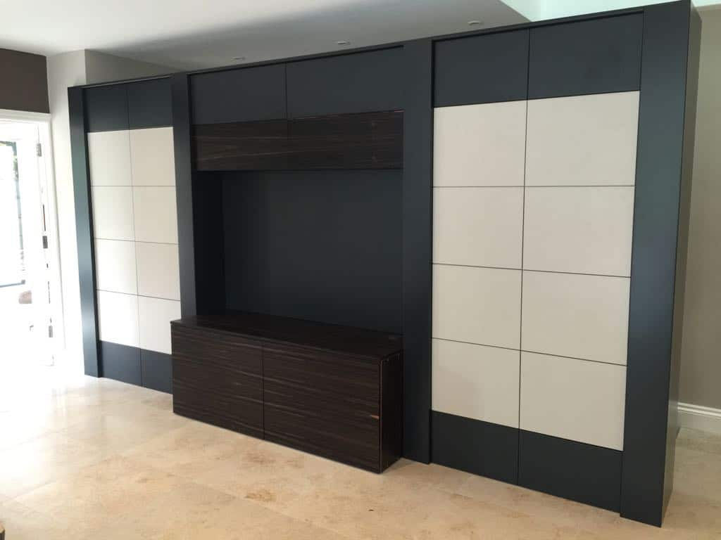 Bespoke TV unit with side storage.